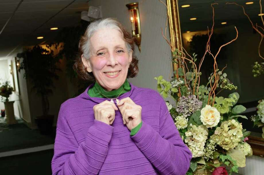 Susan Cohen, of Greenwich, proudly displays the Chinese characters on her necklace, one represents good fortune, the other longevity, in the lobby of her home in Greenwich on Friday, Jan. 6, 2012. Photo: Amy Mortensen / Connecticut Post Freelance