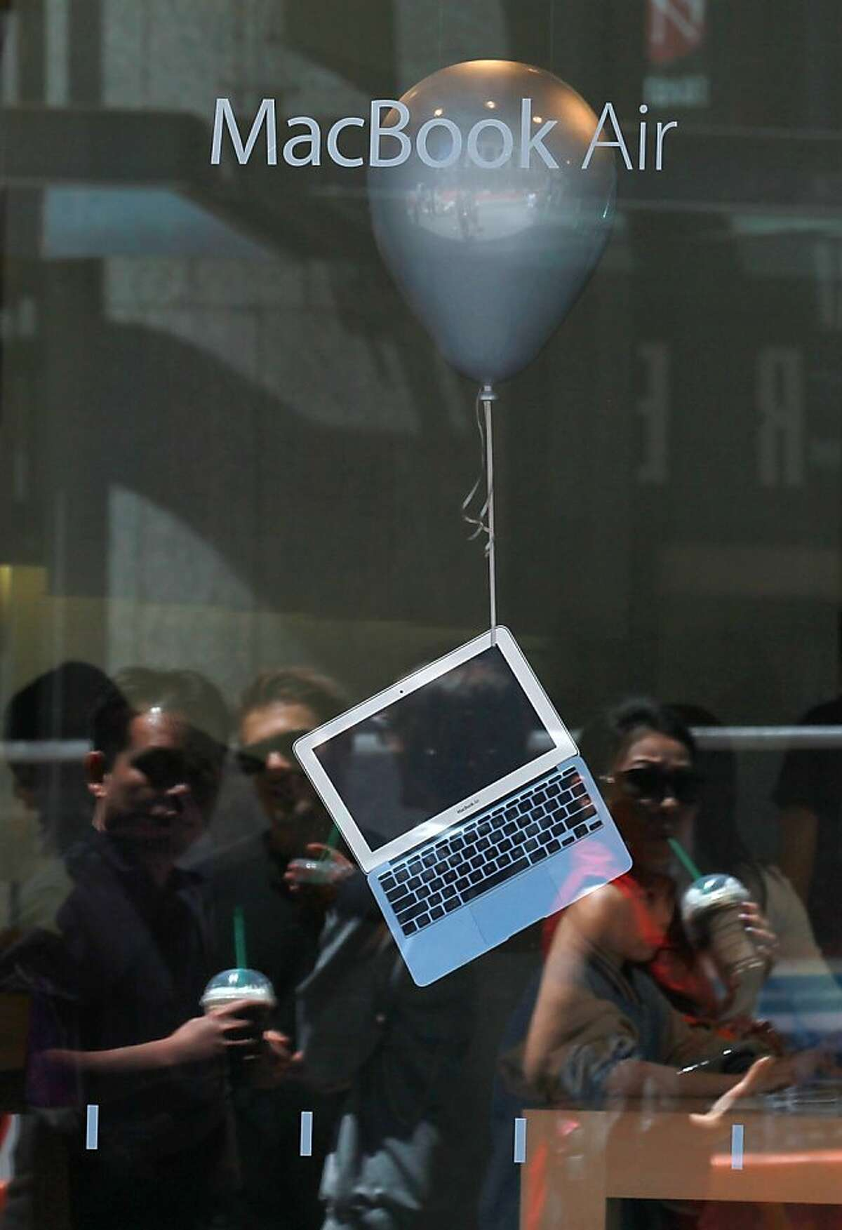 SAN FRANCISCO, CA - JULY 19: A MacBook Air is displayed in the window of an Apple Store on July 19, 2011 in San Francisco, California. Apple Inc. beat Wall Street expectations with a third quarter net profit of $7.31 billion, or $7.79 per share, compared to $3.25 billion, or $3.51 per share one year ago.