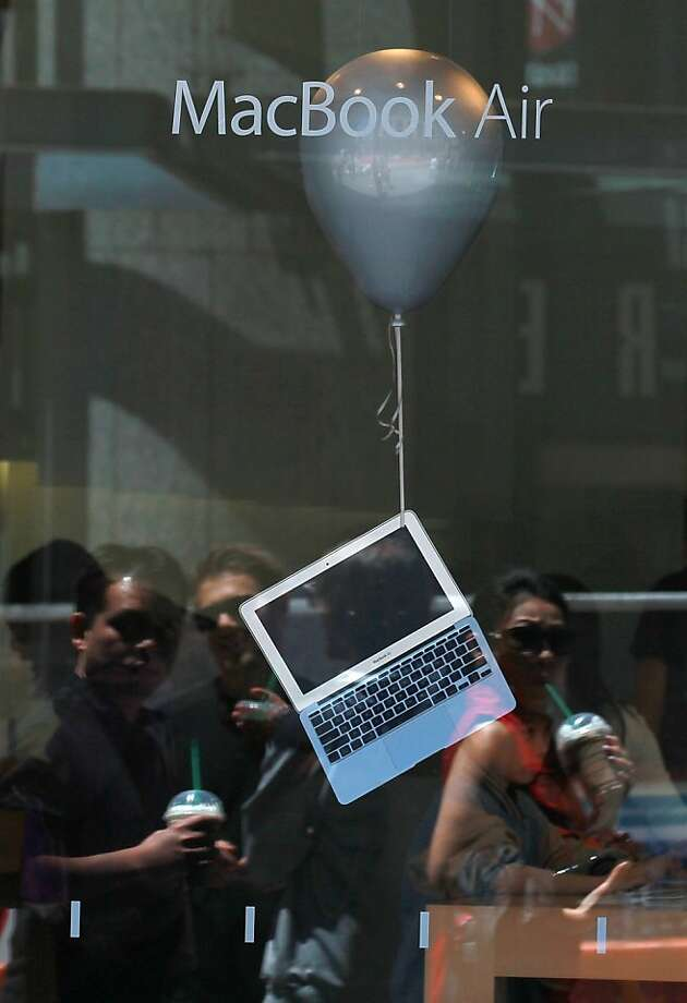 SAN FRANCISCO, CA - JULY 19:  A MacBook Air is displayed in the window of an Apple Store on July 19, 2011 in San Francisco, California.  Apple Inc. beat Wall Street expectations with a third quarter net profit of $7.31 billion, or $7.79 per share, compared to $3.25 billion, or $3.51 per share one year ago. Photo: Justin Sullivan, Getty Images