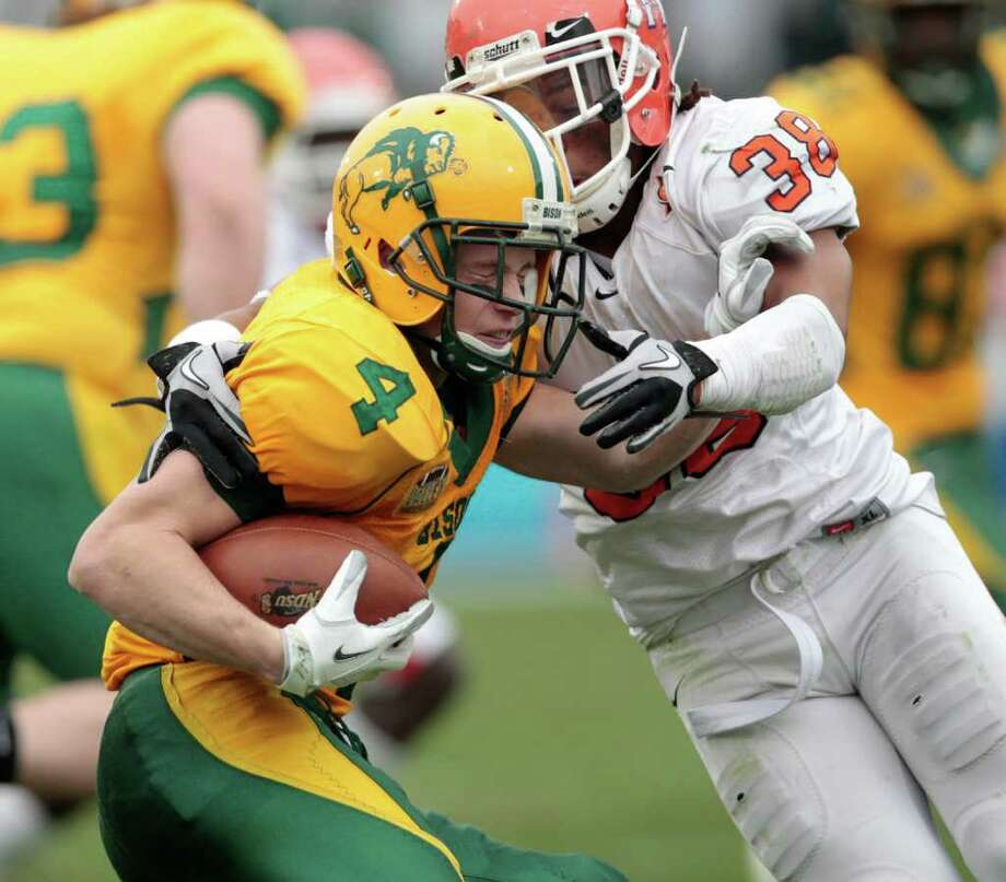 North Dakota State University wideout Ryan Smith (4) is tackled by Sam Houston State University defensive back Darnell Taylor (38) during the first half of  Sam Houston State University  and North Dakota State University match up in the NCAA  2012 Division I Football Championship at Pizza Hut Park in Frisco, Texas  Saturday January 7, 2011. North Dakota State University beat Sam Houston State University 17-6. Photo: Billy Smith II / © 2012 Houston Chronicle