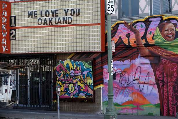 Construction workers work along Park Boulevard where the Parkway theater was once opened, Wednesday January 4, 2012, in OAkland, Calif. After three years, Oakland's beloved movie house will be re-opening uptown within the year .