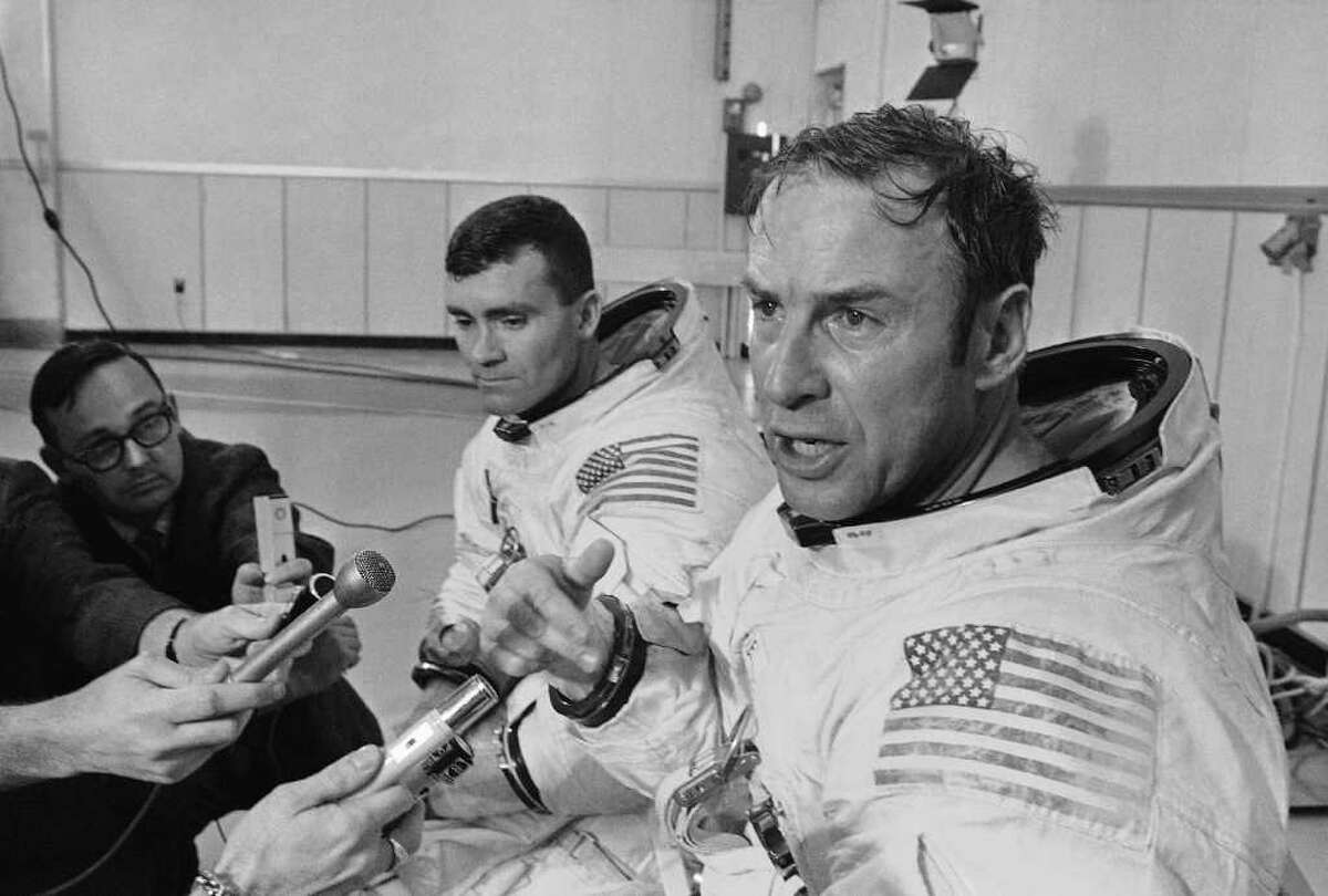 Apollo 13 commander James A. Lovell Jr., foreground, speaks during a news conference in Cape Kennedy, Fla. in April 1970 before the spacecraft launched on its ill-fated journey to the moon. At center is astronaut Fred Haise.