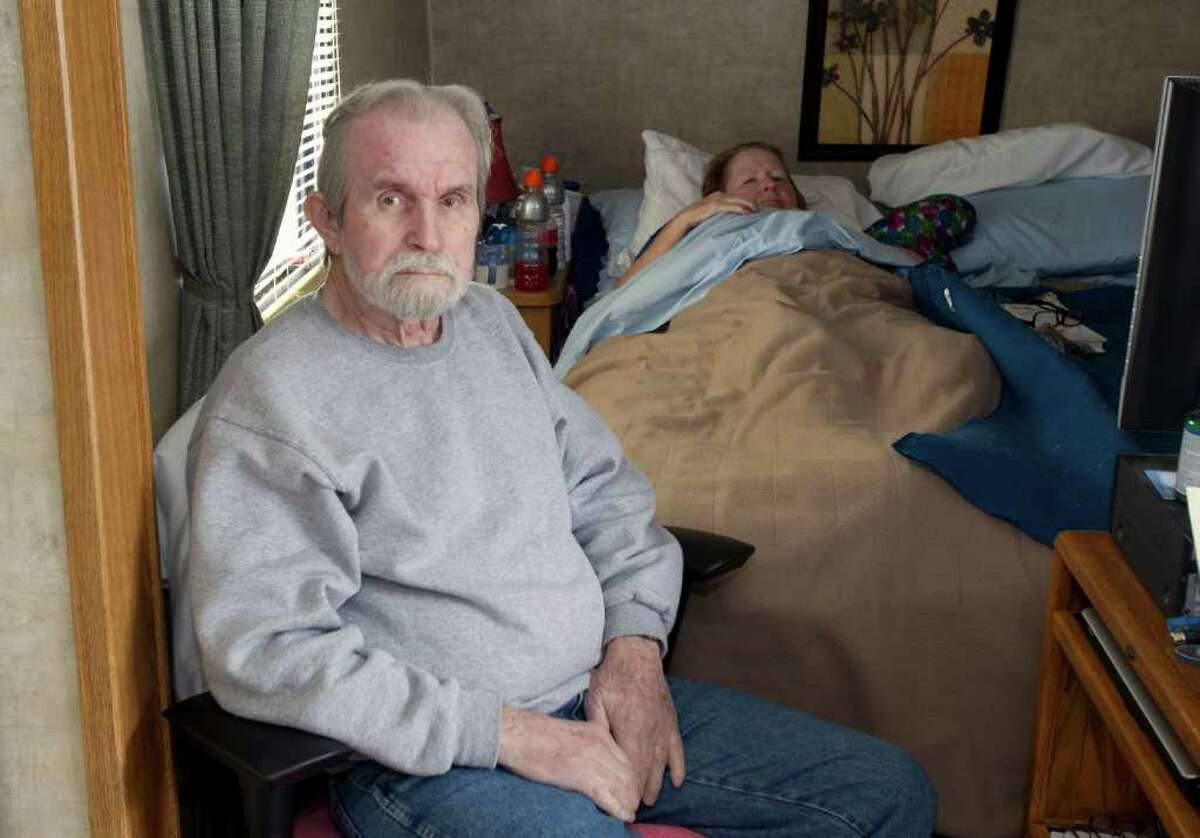 Roy Mooney and his wife, Mary, live in a trailer on the lot where their Port Bolivar home once stood. They both have medical problems and pay someone to assist them with tasks such as purchasing groceries.