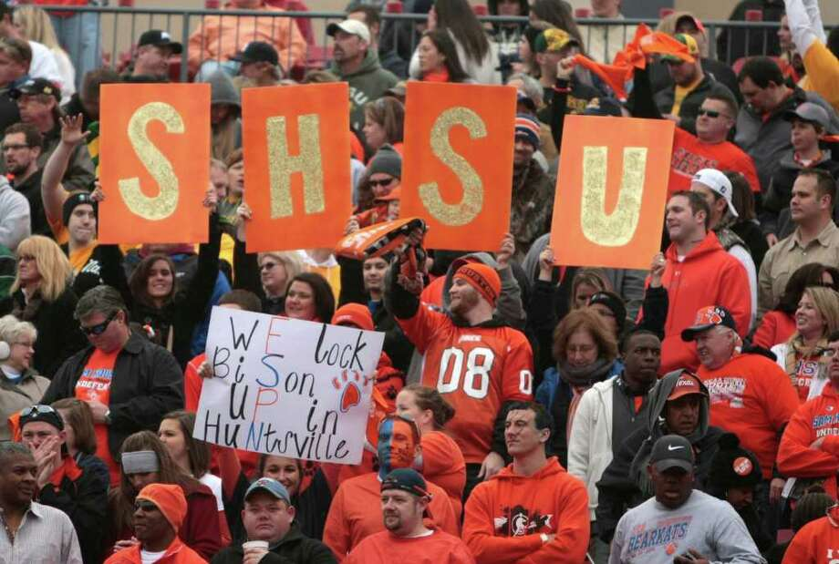 Sam Houston State University fans cheer on their team. During the first half of  Sam Houston State University  and North Dakota State University match up in the 2012 Division I Football Championship at Pizza Hut Park in Frisco, Texas January 7, 2012. )BILLY SMITH II / Houston Chronicle) Photo: Billy Smith II, Chronicle / © 2012 Houston Chronicle