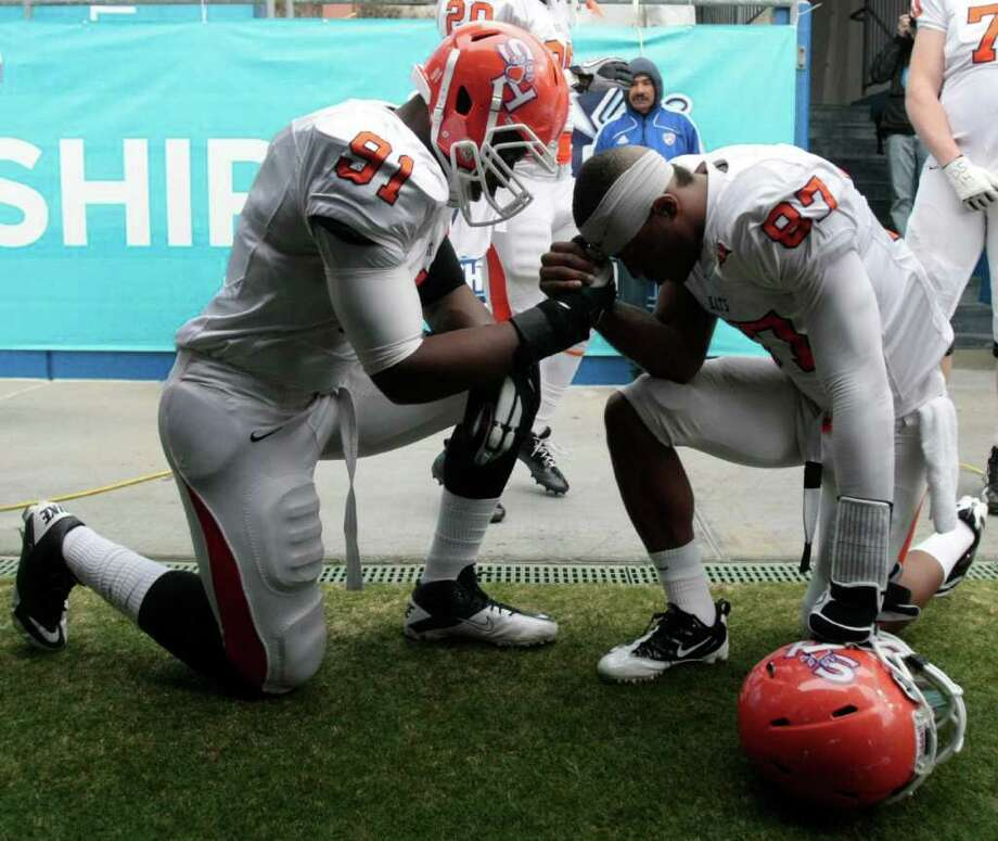 Sam Houston State's  Preston Sanders (91) Keith Blanton (87) pray before the start  of Sam Houston State University  and North Dakota State University match up in the 2012 NCAA  Division I Football Championship at Pizza Hut Park in Frisco, Texas January 7, 2012. Photo: Billy Smith II, Chronicle / © 2012 Houston Chronicle