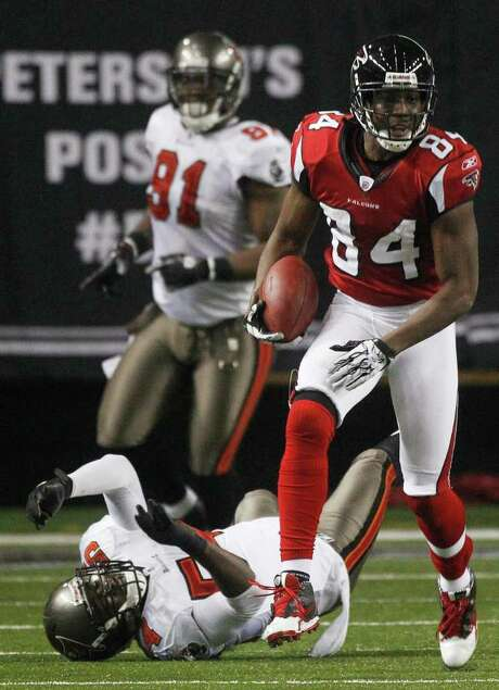 Atlanta Falcons wide receiver Roddy White (84) runs past Tampa Bay Buccaneers linebacker Geno Hayes (54) during the second half of an NFL football game Sunday, Jan. 1, 2012, in Atlanta. White broke the Falcons' franchise record for receiving yards on the play. Photo: AP