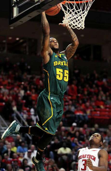 Baylor's Pierre Jackson (55) scores over Texas Tech's DeShon Minnis (3) during their NCAA college basketball game in Lubbock, Texas, on Saturday, Jan. 7, 2012. Photo: AP