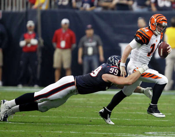 Houston Texans defensive end J.J. Watt (99) sacks Cincinnati Bengals quarterback Andy Dalton (14) during the second quarter of an NFL wild card playoff football game Saturday, Jan. 7, 2012, in Houston. Photo: Eric Gay, Eric Gay, Associated Press / AP