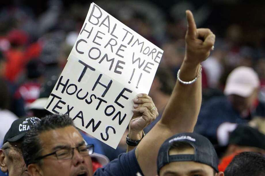 Houston Texans fans cheer their team following the Texans victory over the Cincinnati Bengals in an AFC wildcard playoff football game at Reliant Stadium on Saturday, Jan. 7, 2012, in Houston. The Texans won 31-10. Photo: Smiley N. Pool, Houston Chronicle / © 2012  Houston Chronicle
