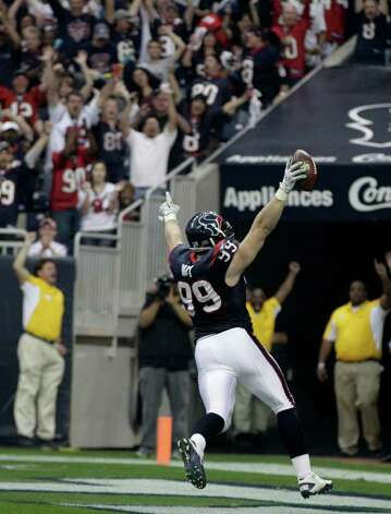 Houston Texans defensive end J.J. Watt (99) scores on an interception against the Cincinnati Bengals during the second quarter of an NFL wild card playoff football game Saturday, Jan. 7, 2012, in Houston. Photo: AP