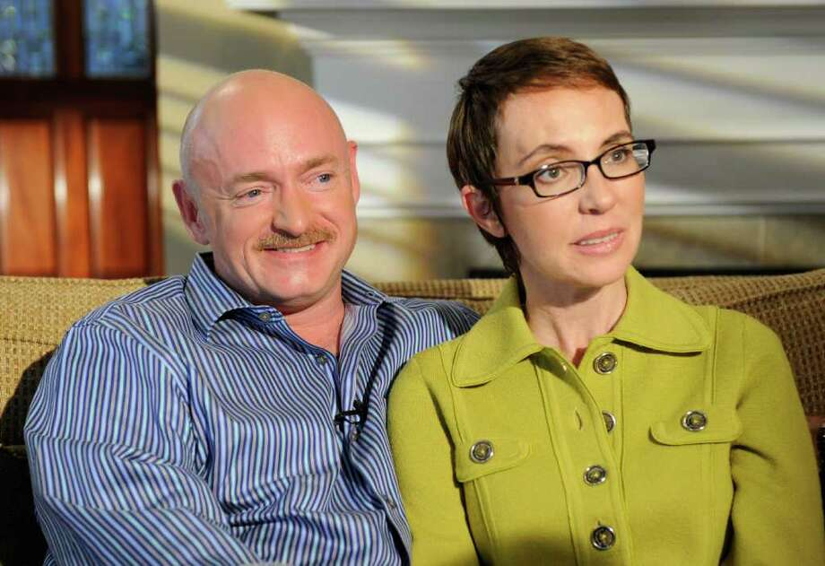 FILE - In this undated photo provided by ABC, U.S. Rep. Gabrielle Giffords and husband Mark Kelly are interviewed by Diane Sawyer on ABC's 20/20.   One year after being shot in the head, Rep. Gabrielle Giffords is on a mission to return to the job she so clearly loved. Her husband and people near the three-term congresswoman say she is highly motivated to recover from her injuries and get back to work in Washington, potentially using her inspirational story as a way to mend political differences in the nation's capital. She faces a May deadline to get on the November ballot, meaning she has a few months to decide her next step.   (AP Photo/ABC, Ida Mae Astute) Photo: Ida Mae Astute