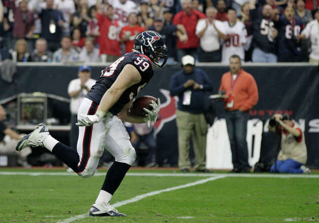 Houston Texans defensive end J.J. Watt heads down field to score on an interception of Cincinnati Bengals quarterback Andy Dalton during the second quarter of an NFL wild card playoff football game Saturday, Jan. 7, 2012, in Houston. Photo: Tony Gutierrez, Tony Gutierrez, Associated Press / AP