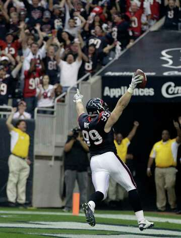 Houston Texans defensive end J.J. Watt (99) scores on an interception against the Cincinnati Bengals during the second quarter of an NFL wild card playoff football game Saturday, Jan. 7, 2012, in Houston. Photo: Tony Gutierrez, Tony Gutierrez, Associated Press / AP