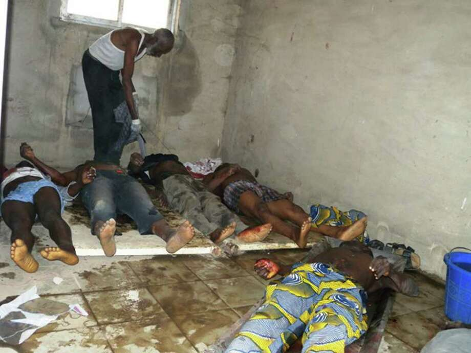 Bodies of people alleged to have been killed in a Friday attack on a town hall meeting of the Christian Igbo ethnic group lie on the floor in a hospital morgue in Mubi, in the Adamawa state of northern Nigeria, Saturday, Jan. 7, 2012. The town hall attack, which left at least 20 dead, is one of a string of deadly attacks claimed by radical Muslim sect Boko Haram, which has promised to kill Christians living in Nigeria's largely Muslim north. At least 44 people have been killed in the last few days alone. (AP Photo) Photo: STR / AP