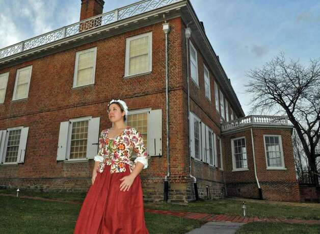 Dressed in 18th-century clothing, Schuyler Mansion State Historic Site volunteer Jillian Borden of Castleton on Hudson outside the Albany site readies for their annual Twelfth Night celebration in Albany Saturday Jan. 7, 2011.   (John Carl D'Annibale / Times Union) Photo: John Carl D'Annibale / 10016013A