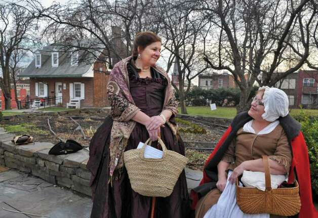 Wearing 18th-century garb, reenactors Chris Northup, left, of Middleburg and Judy Legett of Rome, NY, during the annual Schuyler Mansion State Historic Site's annual Twelfth Night celebration in Albany Saturday Jan. 7, 2011.   (John Carl D'Annibale / Times Union) Photo: John Carl D'Annibale / 10016013A