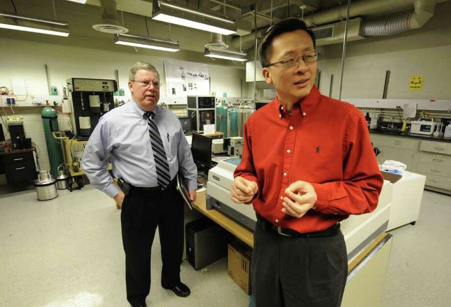 Martin A. Byrne, Associate Director, Center for Future Energy Systems, left and Jian Sun, Director, CEFS speak to the Times Union in their lab on the RPI campus in Troy, N.Y. regarding future programs  Dec. 23, 2011.    (Skip Dickstein/Times Union) Photo: Skip Dickstein
