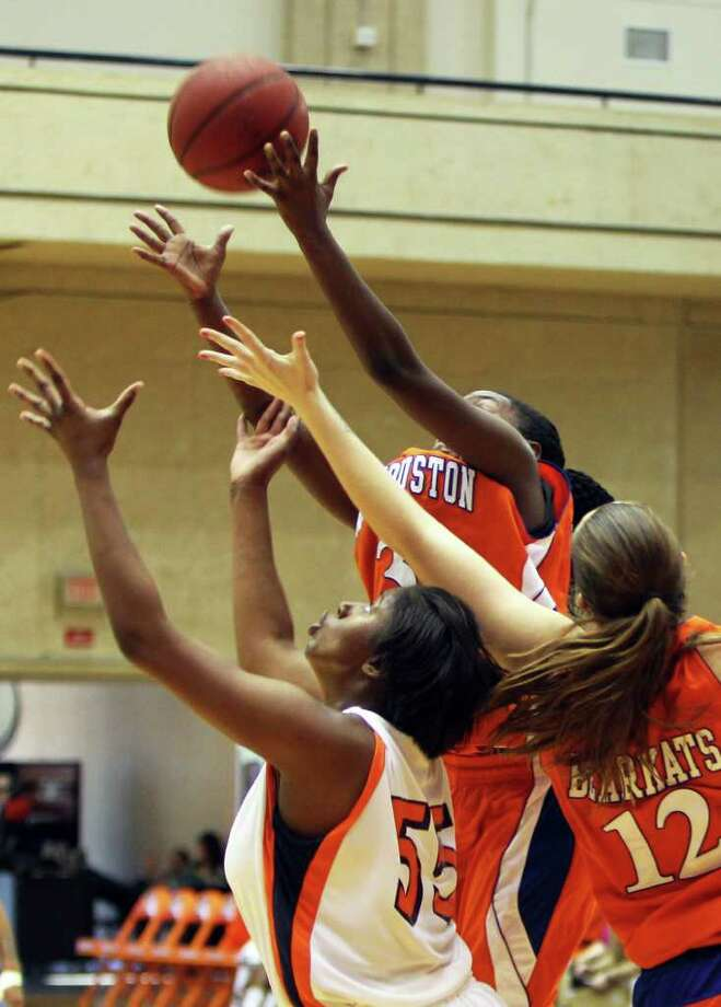 Cori Cooper looks for the rebound under Sam Houston's Jasmine Johnson and Angela Beadle as UTSA took on Sam Houston State in the womens' Southland Conference opener at the UTSA Convocation Center, Saturday, January 7, 2012. Sam Houston won 63-50. Photo: JENNIFER WHITNEY, Jennifer Whitney/ Special To The Express-News / special to the Express-News