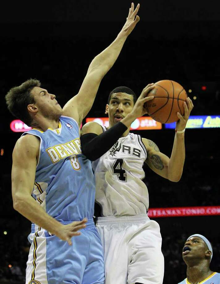 Spurs' Danny Green (04) goes for a shot against the Denver Nuggets' Danilo Gallinari (08) in the first half at the AT&T Center on Saturday, Jan. 7, 2012. Kin Man Hui/kmhui@express-news.net Photo: KIN MAN HUI, SAN ANTONIO EXPRESS-NEWS / SAN ANTONIO EXPRESS-NEWS