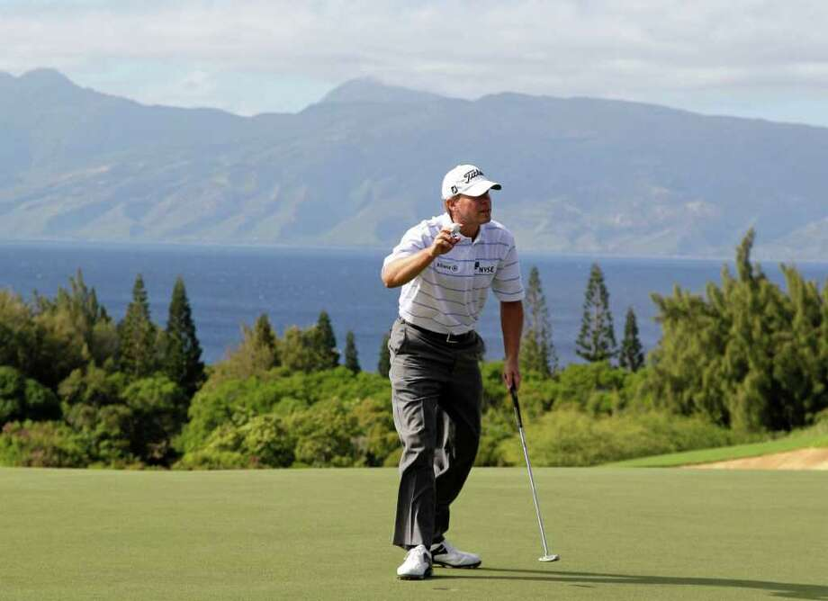 Steve Stricker reacts after making a birdie putt on the ninth green during the second round of the Hyundai Tournament of Champions PGA Tour golf tournament in Kapalua, Hawaii, Saturday, Jan. 7, 2012. Photo: AP