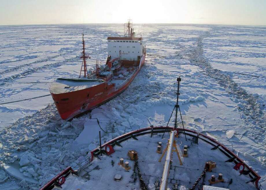 The Russian-flagged tanker Renda, carrying more than 1.3 million gallons of fuel, sits in the ice while the Coast Guard Cutter Healy crew breaks the ice around the tanker approximately 19 miles northwest of Nunivak Island Jan. 6, 2012. The cutter Healy crew is escorting the Renda crew to Nome, Alaska, where the tanker crew will offload the needed fuel to the city. The vessels are transiting through ice up to five-feet thick in this area. The 370-foot tanker Renda will have to go through more than 300 miles of sea ice to get to Nome, a city of about 3,500 people on the western Alaska coastline that did not get its last pre-winter fuel delivery because of a massive storm. If the delivery of diesel fuel and unleaded gasoline is not made, the city likely will run short of fuel supplies before another barge delivery can be made in spring. Photo: Petty Officer 1st Class Sara Francis/USCG / ASSOCIATED PRESS