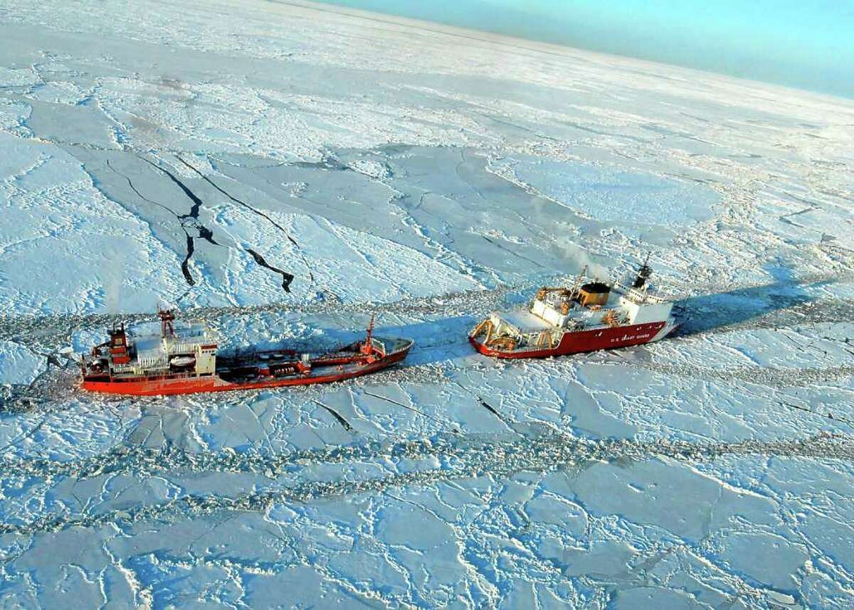 The Coast Guard Cutter Healy escorts the Russian-flagged tanker Renda 250 miles south of Nome Friday Jan. 6, 2012. The vessels are transiting through ice up to five-feet thick in this area. The 370-foot tanker Renda will have to go through more than 300 miles of sea ice to get to Nome, a city of about 3,500 people on the western Alaska coastline that did not get its last pre-winter fuel delivery because of a massive storm. If the delivery of diesel fuel and unleaded gasoline is not made, the city likely will run short of fuel supplies before another barge delivery can be made in spring.