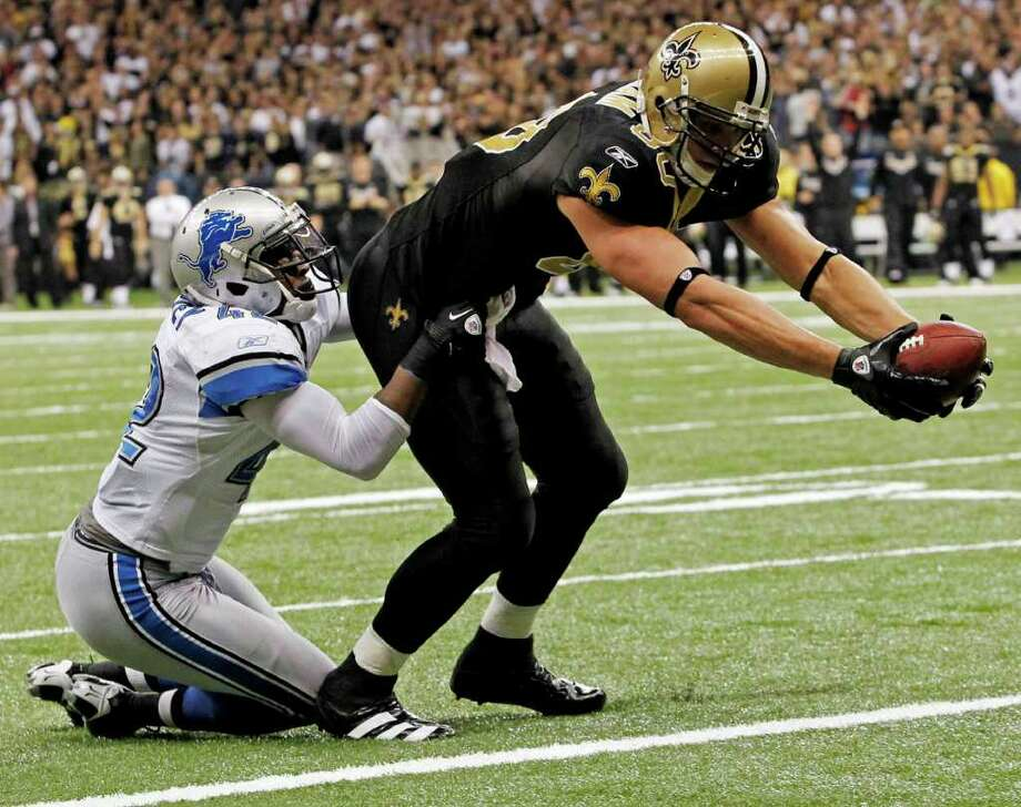 New Orleans Saints' Jimmy Graham (80) reaches for a touchdown with Detroit Lions' Amari Spievey (42) defending during the second half of an NFL wild card playoff football game Saturday, Jan. 7, 2012, in New Orleans. Photo: AP