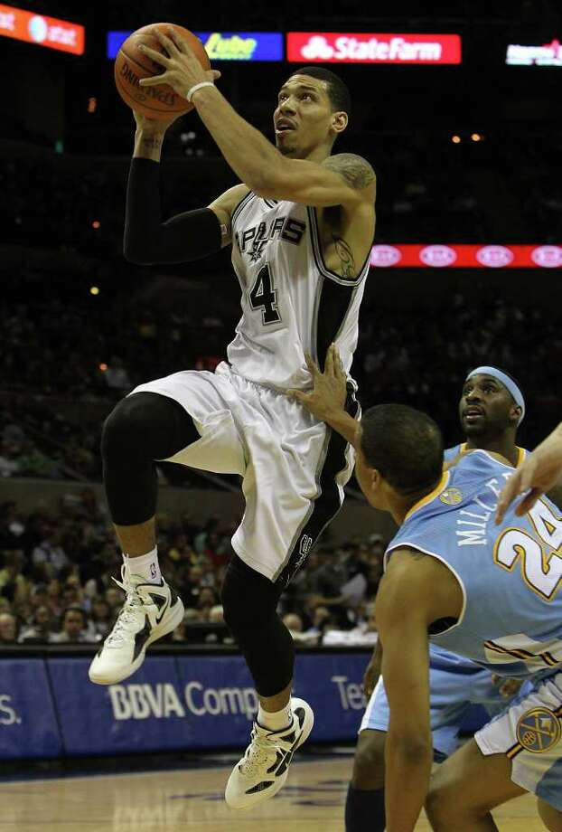 Spurs' Danny Green (04) drives to the basket against the Denver Nuggets' Andre Miller (24) in the first half at the AT&T Center on Saturday, Jan. 7, 2012. Kin Man Hui/kmhui@express-news.net Photo: KIN MAN HUI, SAN ANTONIO EXPRESS-NEWS / SAN ANTONIO EXPRESS-NEWS