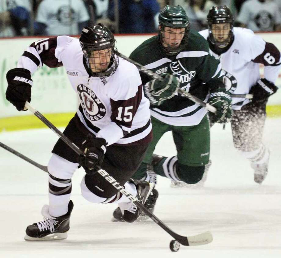 Union's #15 Matt Hatch, left, Dartmouth's #19 Eric Robinson and Union's #6 Charlie Vasaturo, at right, during their game at Union College's Messa Rink in  Schenectady Saturday Jan. 7, 2012.  (John Carl D'Annibale / Times Union) Photo: John Carl D'Annibale / 10016014A