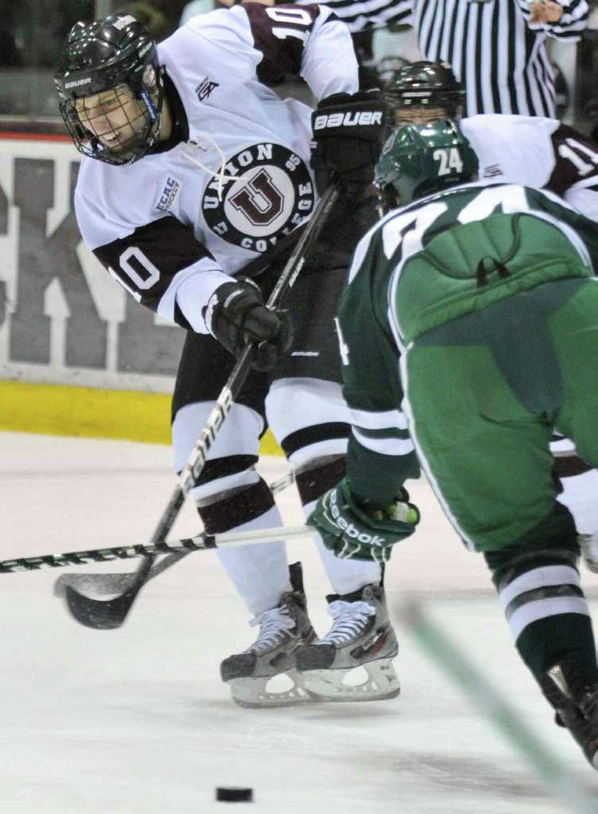 Union's #11 Mark Bennett, left, shoots past Dartmouth's #24Andy Simpson during their game at Union College's Messa Rink in Schenectady Saturday Jan. 7, 2012. (John Carl D'Annibale / Times Union)