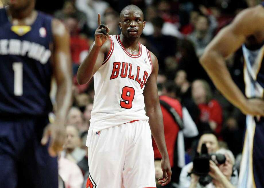 Chicago Bulls' Luol Deng (9) reacts after scoring during the third quarter of an NBA basketball game against the Memphis Grizzlies in Chicago on Sunday, Jan. 1, 2012. (AP Photo/Nam Y. Huh) Photo: Nam Y. Huh / AP