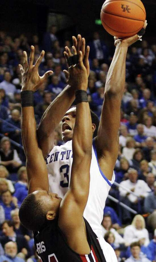 Kentucky's Terrence Jones, rear, shoots over South Carolina's Damontre Harris during the second half of an NCAA college basketball game in Lexington, Ky., Saturday, Jan. 7, 2012. Kentucky won 79-64. (AP Photo/James Crisp) Photo: James Crisp