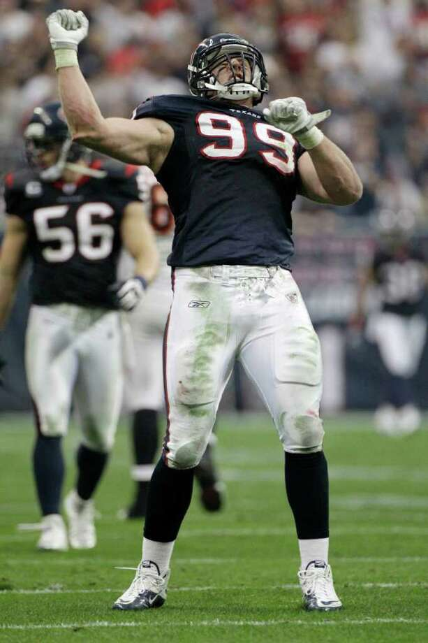Houston Texans defensive end J.J. Watt celebrates his touchdown on an interception of Cincinnati Bengals quarterback Andy Dalton during the second quarter of an NFL wild card playoff football game Saturday, Jan. 7, 2012, in Houston. (AP Photo/Tony Gutierrez) Photo: Tony Gutierrez