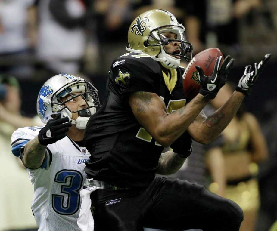 New Orleans Saints wide receiver Robert Meachem (17) hauls in a pass as Detroit Lions cornerback Aaron Berry (32) defends during the second half of an NFL wild card playoff football game Saturday, Jan. 7, 2012, in New Orleans. (AP Photo/David J. Phillip) Photo: David J. Phillip