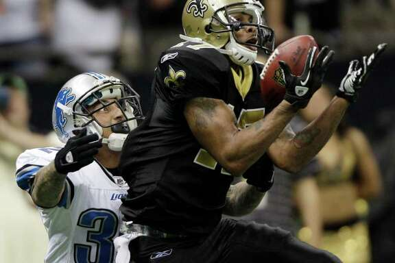 New Orleans Saints wide receiver Robert Meachem (17) hauls in a pass as Detroit Lions cornerback Aaron Berry (32) defends during the second half of an NFL wild card playoff football game Saturday, Jan. 7, 2012, in New Orleans. (AP Photo/David J. Phillip)