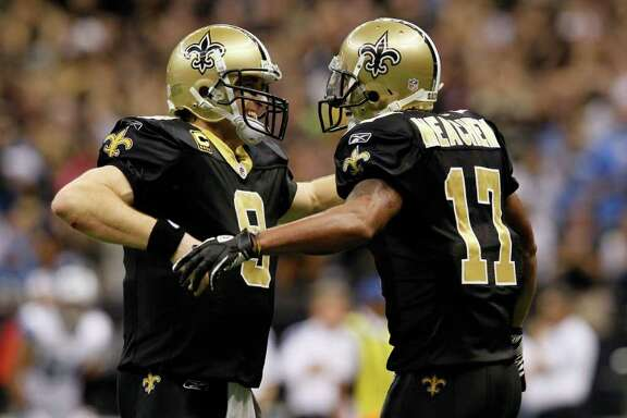 Saints quarterback Drew Brees, left, and receiver Robert Meachem celebrate their fourth-quarter TD.