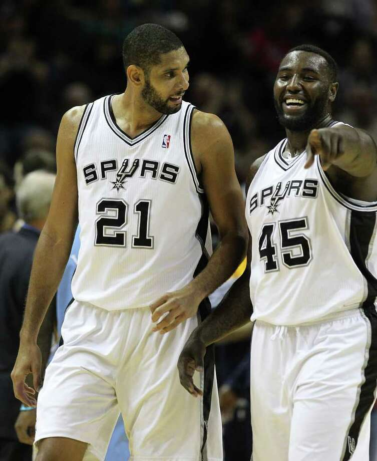 Spurs' Tim Duncan (left) and DuJuan Blair discuss a play during a timeout against the Denver Nuggets in the first half at the AT&T Center on Saturday, Jan. 7, 2012. Kin Man Hui/kmhui@express-news.net Photo: KIN MAN HUI, ~ / SAN ANTONIO EXPRESS-NEWS