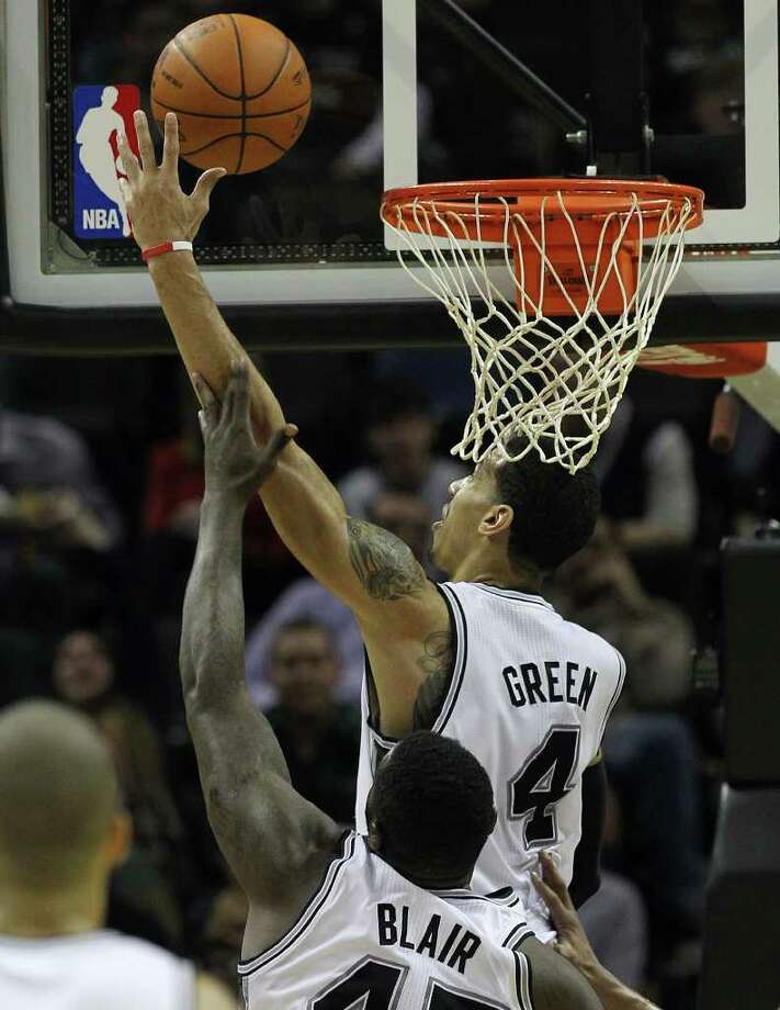 Spurs' Danny Green (04) gets help from teammate DeJuan Blair in putting up a shot against the Denver Nuggets in the second half at the AT&T Center on Saturday, Jan. 7, 2012. Spurs won 121-117. Kin Man Hui/kmhui@express-news.net Photo: KIN MAN HUI, ~ / SAN ANTONIO EXPRESS-NEWS