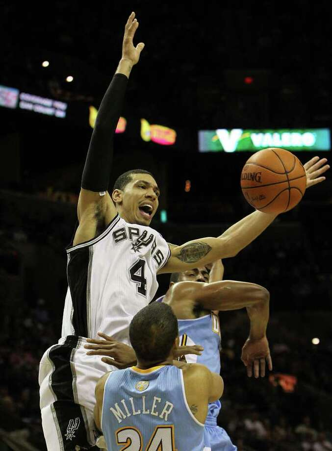 Spurs' Danny Green (04) gets fouled while going up for a shot against the Denver Nuggets' Andre Miller (24) and Arron Afflalo (06) in the first half at the AT&T Center on Saturday, Jan. 7, 2012. Kin Man Hui/kmhui@express-news.net Photo: KIN MAN HUI, ~ / SAN ANTONIO EXPRESS-NEWS