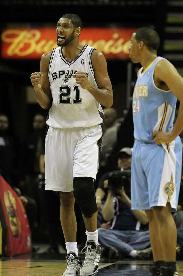 Spurs' Tim Duncan (21) reacts during the game against the Denver Nuggets in the second half at the AT&T Center on Saturday, Jan. 7, 2012. Spurs won 121-117. Kin Man Hui/kmhui@express-news.net Photo: KIN MAN HUI, ~ / SAN ANTONIO EXPRESS-NEWS