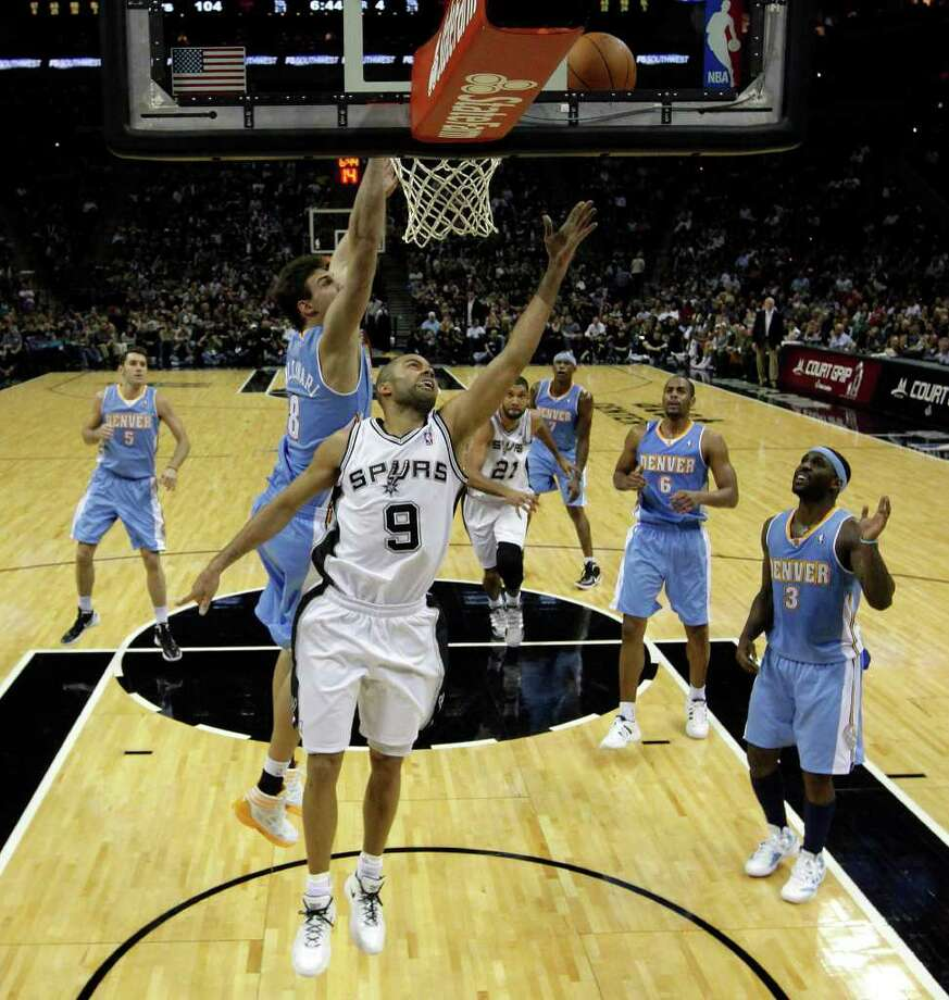 Spurs' Tony Parker (09) drives underneath the basket against the Denver Nuggets' Danilo Gallinari (08) in the second half at the AT&T Center on Saturday, Jan. 7, 2012. Spurs won 121-117. Kin Man Hui/kmhui@express-news.net Photo: KIN MAN HUI, ~ / SAN ANTONIO EXPRESS-NEWS