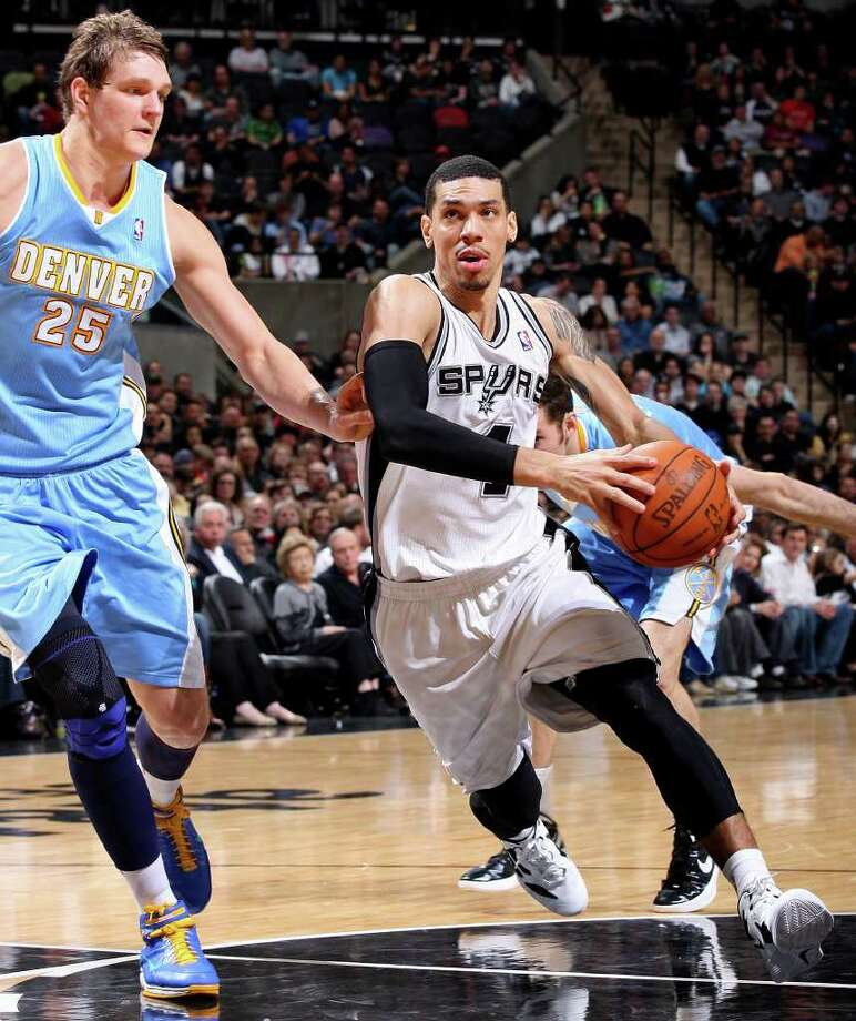 FOR SPORTS - San Antonio Spurs' Danny Green drives to the basket around Denver Nuggets' Timofey Mozgov during second half action Saturday Jan. 7, 2012 at the AT&T Center. The Spurs won 121-117. Photo: EDWARD A. ORNELAS / SAN ANTONIO EXPRESS-NEWS (NFS)