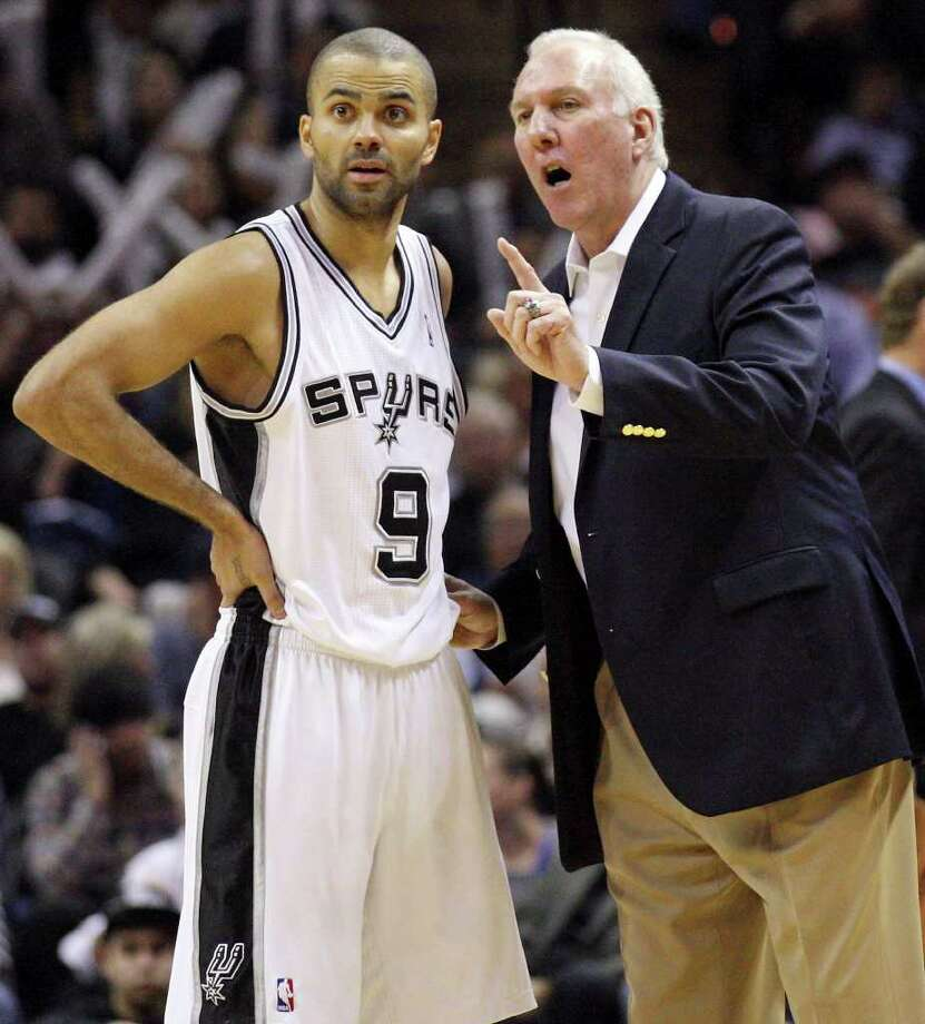 FOR SPORTS - San Antonio Spurs' Tony Parker (left) talks with San Antonio Spurs' head coach Gregg Popovich during second half action against the Denver Nuggets Saturday Jan. 7, 2012 at the AT&T Center. The Spurs won 121-117. Photo: EDWARD A. ORNELAS / SAN ANTONIO EXPRESS-NEWS (NFS)