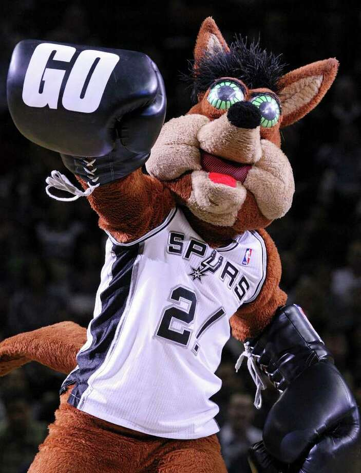 FOR SPORTS - The San Antonio Spurs' Coyote performs during the game with the Denver Nuggets Saturday Jan. 7, 2012 at the AT&T Center. The Spurs won 121-117. Photo: EDWARD A. ORNELAS / SAN ANTONIO EXPRESS-NEWS (NFS)