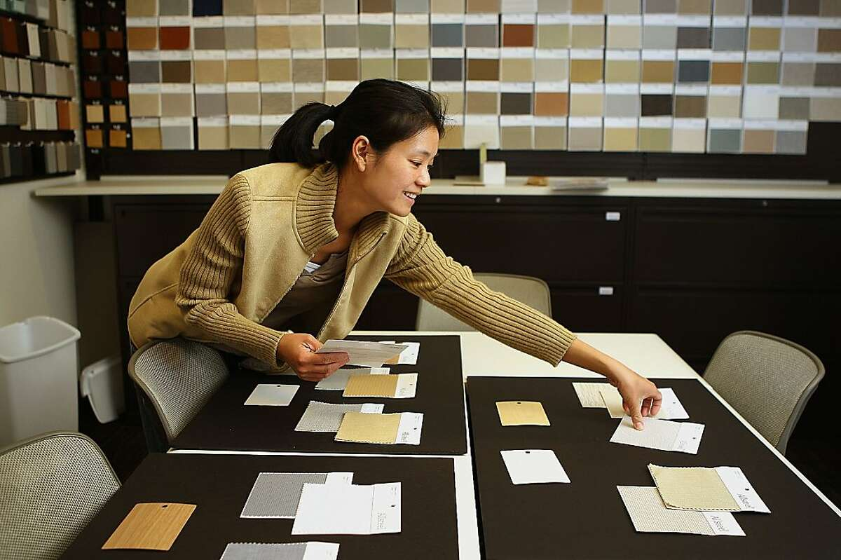 Director of design Candy Tan putting together finish boards for client presentation at SamClar office furniture in Concord, Calif., on Friday, January 6, 2012.