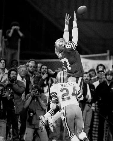 """Then there are iconic sports moments. On the outside, we have to pick The Catch, featuring Dwight Clark and Joe Montana in the 1982 NFC championship game. A real plus is that it came against """"America's Team,"""" the Dallas Cowboys. Iconic enough that a whole book has been written about it.Photo by John Storey/ San Francisco Examiner/Bancroft Library Photo: John Storey, Bancroft Library"""