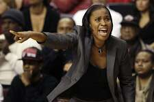 Cincinnati head coach Jamelle Elliot shouts to her players during the first half of an NCAA college basketball game against Rutgers in Piscataway, N.J., Saturday, Jan. 7, 2012. Rutgers' won 58-47. (AP Photo/Mel Evans)