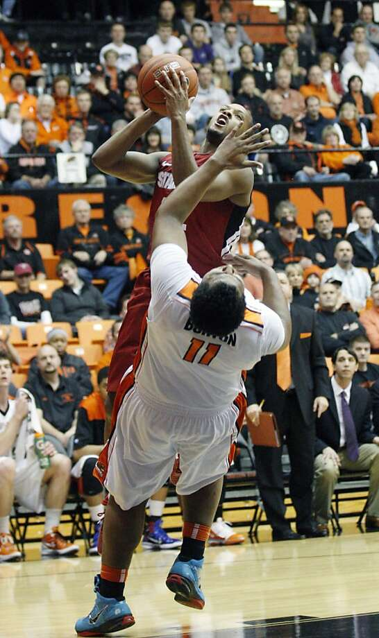 Stanford's Jarrett Mann (22) is fouled by Oregon State's Joe Burton (11) during the first half of an NCAA college basketball game Saturday, Jan. 7, 2012, in Eugene, Ore. (AP Photo/Rick Bowmer) Photo: Rick Bowmer, Associated Press