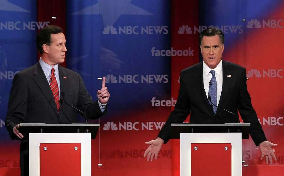CONCORD, NH - JANUARY 08:  Republican presidential candidates, former U.S. Sen. Rick Santorum (L) and former Massachusetts Gov. Mitt Romney (R) participate during the NBC News Facebook Debate on 'Meet the Press' January 8, 2012 at the Capitol Center for the Arts in Concord, New Hampshire. The candidates participated in the last debate before the primary election on Tuesday. Photo: Alex Wong, Getty Images / 2012 Getty Images