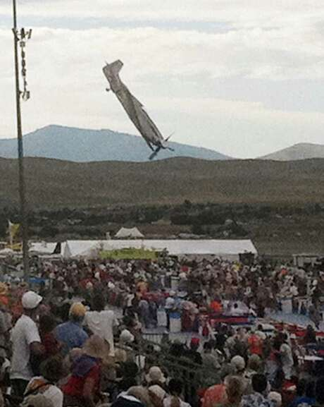 A vintage World War II-era fighter plane approaches the ground right before crashing during the September air show in Reno, Nev. Photo: FILE PHOTO, ASSOCIATED PRESS